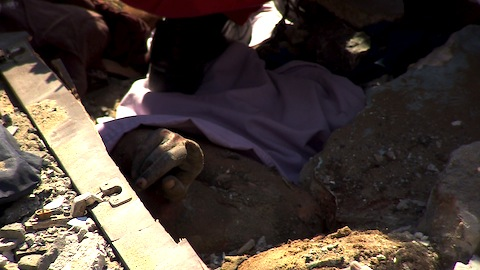 Asmaa el-Helou's hand as she is discovered in the rubble of Shejaiya